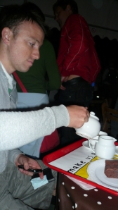 Mike pours us tea in Mr Scruff's Tent